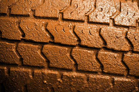Close-up of a muddy  tire surface