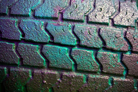 Close-up of a  tire surface covered with colorful toxic residues photo