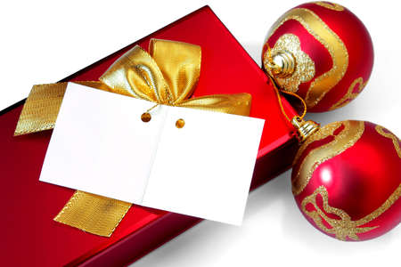 Red Christmas present with two decorative balls and a blank greetings card photo