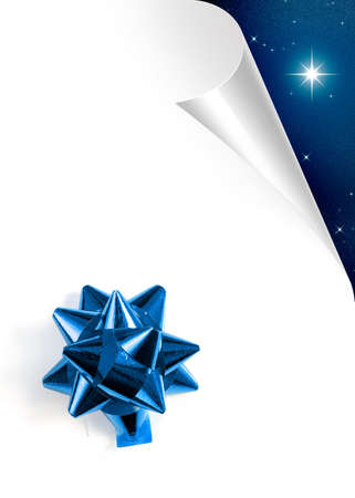 stary: Turning white paper page with blue Christmas bow Stock Photo