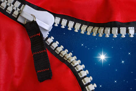 unzipped: Opened zipper on red fabric showing a starry night with shining star