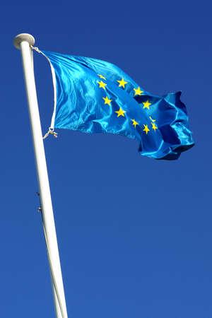 Flag of the european union over a deep blue sky photo