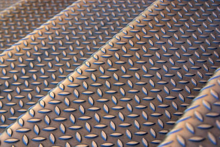 bumpy: Background photo of a industrial metallic stairs with bumpy pattern