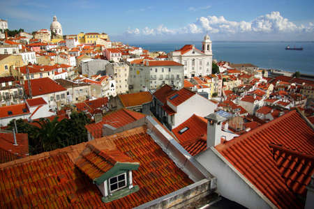 tagus: Panorama of old traditional city of Lisbon with red roofs and view of river Tagus Stock Photo