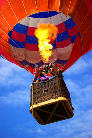 Colorful hot air balloon with bright burning flame Stock Photo