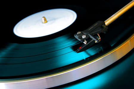 Close up on a vinyl record playing on a turntable photo