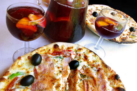 italian restaurant: Pizza and sangria served in an italian restaurant