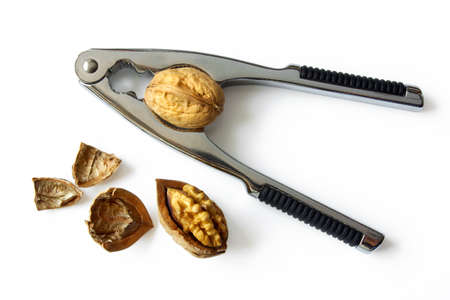 nut cracker: Photo of a nut cracker and nuts isolated in white Stock Photo