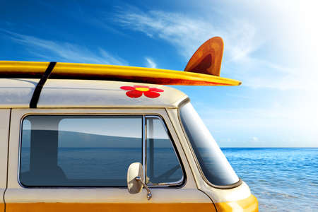 surfboard fin: Detail of a vintage van in the beach, with a surfboard on the roof Stock Photo