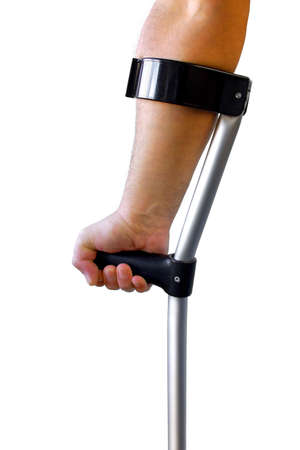Male arm and hand holding a crutch isolated in white photo