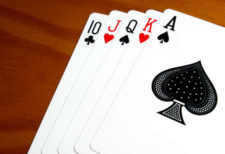 A good set of playing cards with the ace of spades in the front