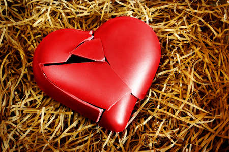 broken relationship: Photo with a broken heart protected with straws Stock Photo