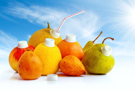 Assorted fruits as juice containers ready to drink with a straw photo