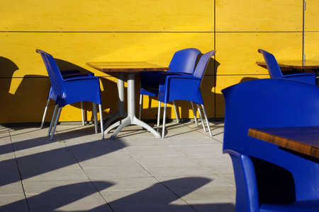 Empty tables in a esplanade of modern coffee shop photo