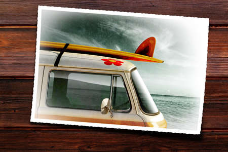 surfboard fin: Wooden table with old photographic print of a van with a surfboard