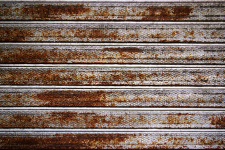 Background photo of a rusty old iron rolling shutter photo