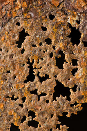 Background photo of a rusty old iron surface with holes photo
