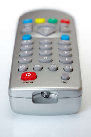 Closeup photo of a television remote control over white background photo