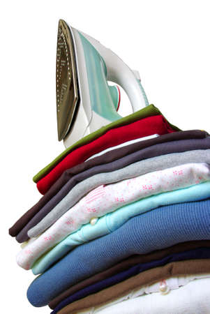 knickers: Pile of assorted clothes and iron isolated in white background