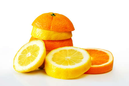 Composition of a pile of juicy orange and lemon slices photo