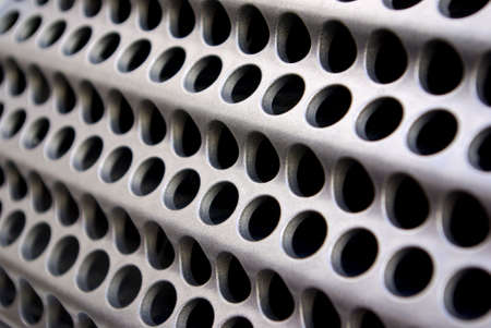 Background of wavy metallic grid with holes Stock Photo - 4967046