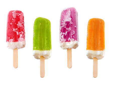 Four refreshing and colorful ice popsicles isolated in white