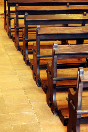 Row of wooden pews inside of a church photo
