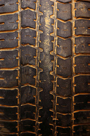Closeup photo of a muddy car tire surface photo