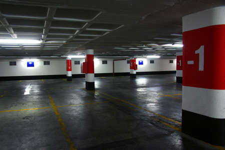 Empty underground parking lot with big concrete columns