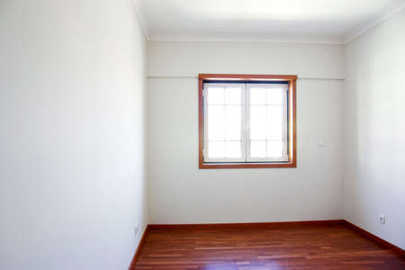 Empty room with a window and white walls in a new house Stock Photo - 5377707