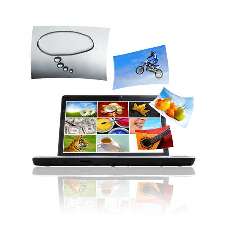 Compositions of photos detaching and flying over a laptop Stock Photo - 5597246