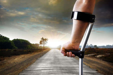 handicapped person: Limping slowly towards the objective - concept