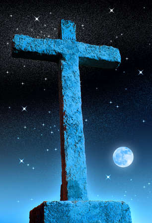 Stone cross at night over a blue starry sky with full moon photo