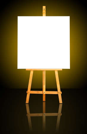 One blank white canvas on easel over a dark gold background photo