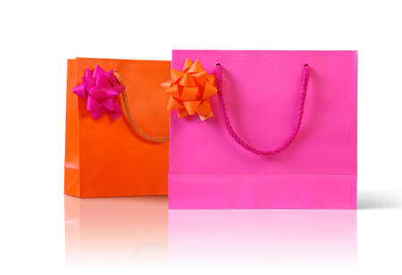 Pink an orange gift paper bags with bows isolated in white background photo