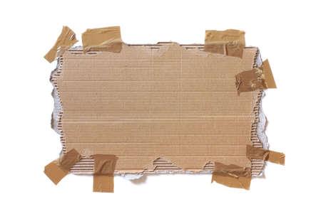 carton: Rasgados de cart�n pegado con cinta aislado en blanco Foto de archivo