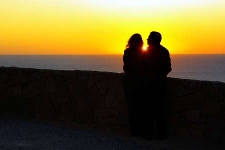 Silhouette of a loving couple against a beautiful sunset Stock Photo - 6446142