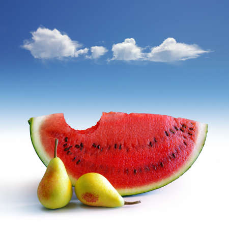 Two pear and a bitten watermelon under a blue sky with a cloud Stock Photo - 6478471
