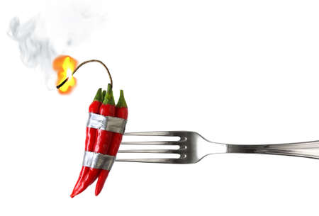 taped: fork with group of red chilli peppers with burning fuse taped like dynamite