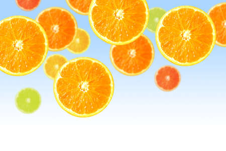 Juicy orange and lemon slices falling down over blue and white background Stock Photo - 6582445
