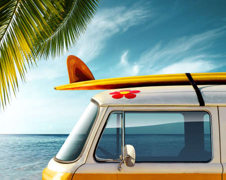 surfboard fin: Detail of a vintage van in the beach with a surfboard on the roof