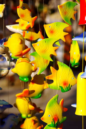 chimes: detail of colorful handmade wind chimes with fish motives