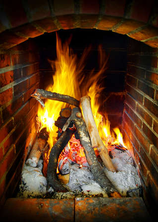 Fireplace brick frame with burning flames