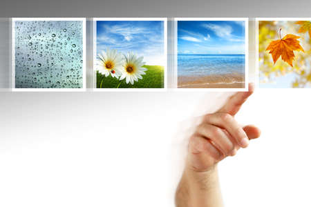 scrolling: human hand scrolling images in a touch screen of a modern display Stock Photo