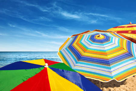 parasol: Detail of colorful sunshades in the beach on a sunny summer day