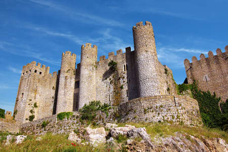 Medieval castle in the portuguese village of Obidos photo