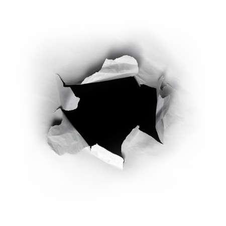 penetracion: Arranc� el orificio redondo en papel blanco con fondo negro dentro de  Foto de archivo