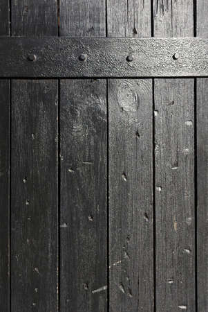 squalid: Background photo of old and textured black wooden planks