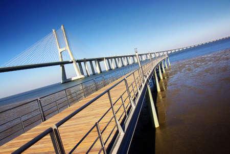 Vasco da Gama Bridge and a walkway in a surrounding park - Lisbon Portugal Stock Photo - 7573772