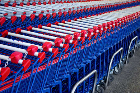 put together: Detail of a rows of supermarket karts tidy put together. Stock Photo